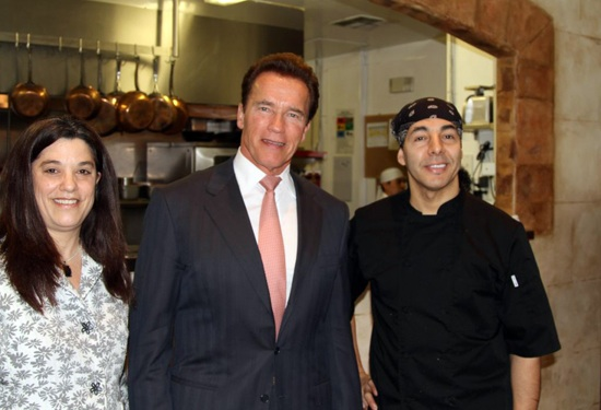 Governor Arnold Schwarzenegger poses with the owners of Zitune in downtown Los Altos.