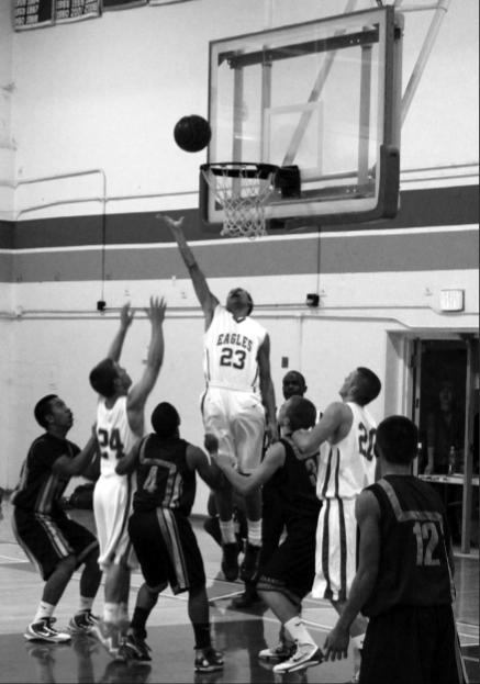 Junior Derek Breaux reaches for a rebound in a rebound in a game against Wilcox. The Eagles are top in the De Anza Division with an overall record of 14-5.