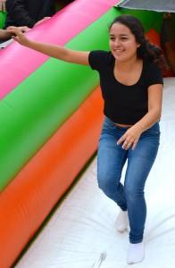 Junior Daniela Gomez runs down an inflatable. Photo by Ian Mackey.